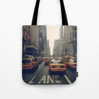 fifth element Tote Bags featuring Fifth Avenue  by Laura Ruth