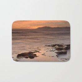 """Last red light"" Sunset at the sea Bath Mat"
