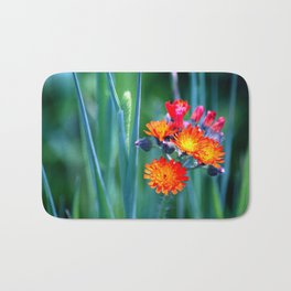 Fire Colors in the Greenery Bath Mat