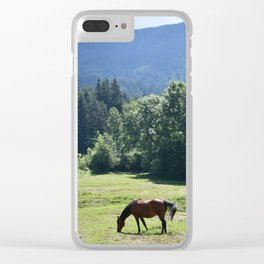 Horses grazing in a mountain meadow Clear iPhone Case