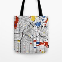 los angeles Tote Bags featuring Los Angeles by Mondrian Maps
