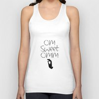om Tank Tops featuring OM by Surya