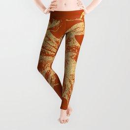 Gold octopus on burnt orange background Leggings