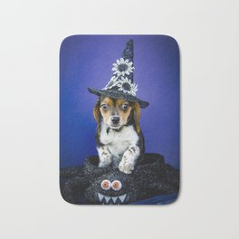 Tiny Tricolor Beagle Puppy Wearing a Fashion Witch Hat Poses in a Halloween Spider Basket Bath Mat