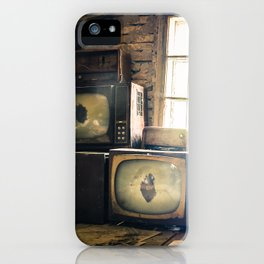 Old televisions in a dusty attic iPhone Case