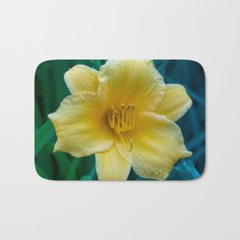 Yellow Day Lily on Green Blue Background Bath Mat