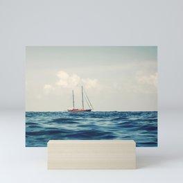 Wooden Sailboat Sailing on the Horizon, Open Blue sea Mini Art Print