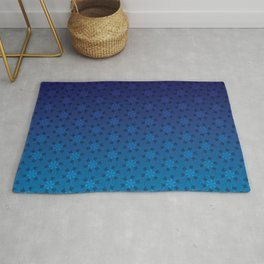 Floral Pattern of Abstract Pinwheels in Blue Gradient Ombré Rug