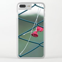 Deflated red balloon on fence net Clear iPhone Case