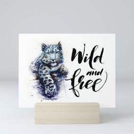 Snow leopard wild and free Mini Art Print