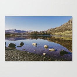 rocks on the shore. rydal water, lake district, uk Canvas Print