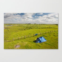 Camping tent and grass expanse Canvas Print