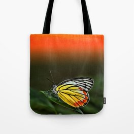 Butterfly Staring at Sunset Tote Bag