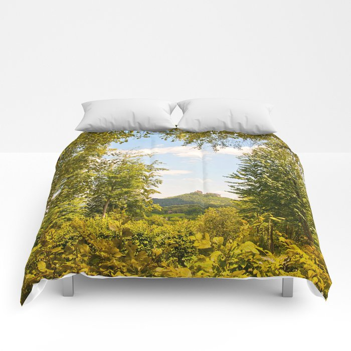 Trifels castle framed by green trees Comforters