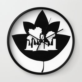 Pollution through Negative Space in Leaf Wall Clock