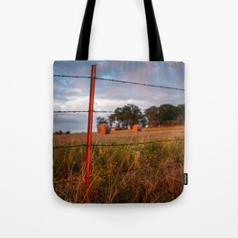 Round Bales and Barbed Wire at Sunset Tote Bag