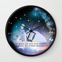 """le petit prince Wall Clocks featuring """"The Little Prince"""" (""""Le Petit Prince"""") by Antoine de Saint-Exupéry  by cvrcak"""