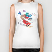 skiing Biker Tanks featuring Santa Skiing 1 by drawgood