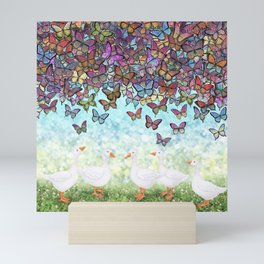 butterfly cascade and white geese Mini Art Print