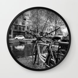 Bicycles and boats along Amsterdam canal Wall Clock