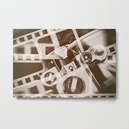 Retro SLR camera on background film Metal Print