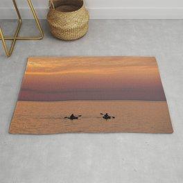 Kayaking in the sunset Rug