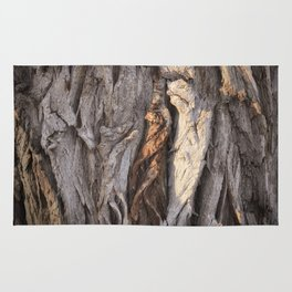 Abstract Human Figures in Gnarled Wood and White Cinder Block Rug