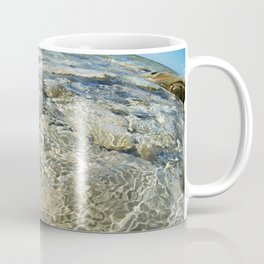 Beautiful water surface on rocky seashore Coffee Mug