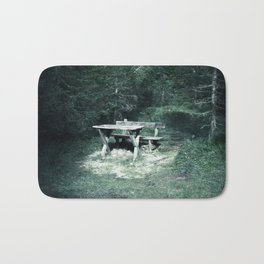 Bench and table in the dark forest Bath Mat