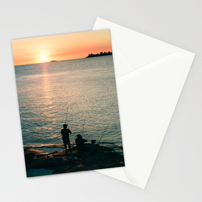 Three fisherman enjoy a beautiful sunset at the shore of 'Colonia del Sacramento, Uruguay'. Stationery Cards