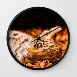 Jaguar Cub Lying in Foliage Wall Clock