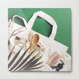 Zero waste concept. Cotton bag, bamboo cultery, glass jar, bamboo toothbrushes, hairbrush and straws on green background Metal Print