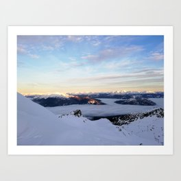 Morning light sweeping mountain peaks above sea of clouds Art Print