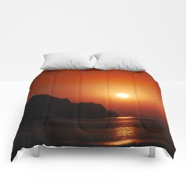 Sunset at the sea Comforters
