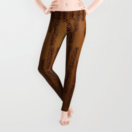 Eye of the Magpie tribal style pattern - bronze Leggings