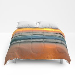 Golden sunset with turquoise waters Comforters