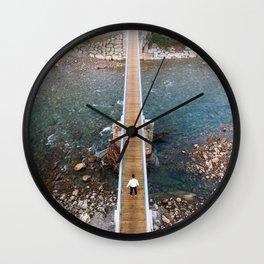 Crossing a bridge Wall Clock