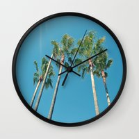 palm tree Wall Clocks featuring Palm tree by Laura James Cook