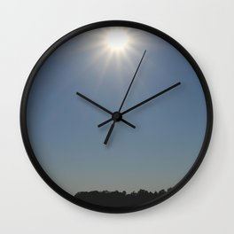 Silhouettes of two people on a rubber boat in a sunny reflection Wall Clock