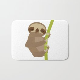 funny and cute smiling Three-toed sloth on green branch Bath Mat