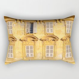 Yellow facade, with antique windows and shutters, a vintage building in Nice, France Rectangular Pillow