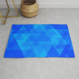 Bright blue and celestial triangles in the intersection and overlay. Rug