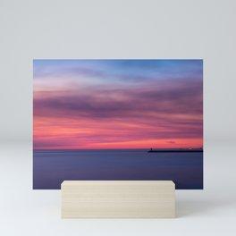 Red sunset over the ocean Mini Art Print