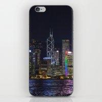 hong kong iPhone & iPod Skins featuring Hong Kong Night Skyline by Deborah Janke