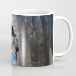 Freedom, Beautiful young woman with dress made of blue feathers, angel fallen from heaven to earth. Coffee Mug