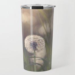 Dandelion blossom defocused in garden Travel Mug