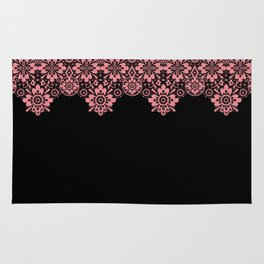 Retro .Vintage . Pink lace on a black background . Rug
