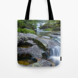 Waterfalls in wild forest Tote Bag