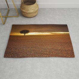 Ancient Oak Amid Ploughed Crop Field Italian sunset Rug