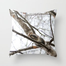 Squirrel eating on a tree Throw Pillow